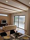 1号地LDK・約17.5帖・南側掃出し窓リモコン式自動シャッター雨戸・三面床暖房(リビング・ダイニング・キッチン)・トップライト