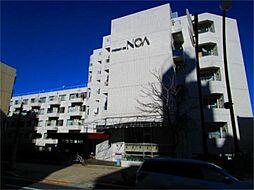 東京都多摩市一ノ宮1丁目の賃貸マンションの外観