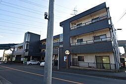 神奈川県伊勢原市西富岡の賃貸マンションの外観