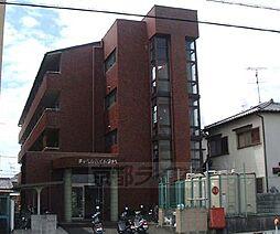 京都府京田辺市三山木見尊田の賃貸マンションの外観