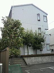 東京都町田市鶴川5丁目の賃貸マンションの外観