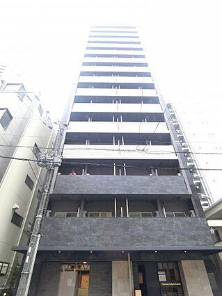 西区に建つ15階建ての分譲賃貸マンション。