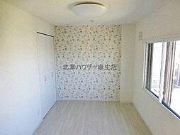 クレアトゥール麻生の洋室