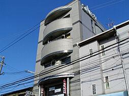 ジェノバビル巣本[4階]の外観