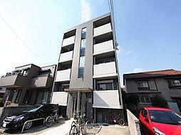 フラット矢田南の外観 デザイナーズ 外壁タイル張り 敷地内平面駐車場
