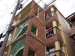 大阪府四條畷市二丁通町の賃貸マンションの外観